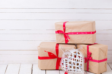 Festive gift boxes  on white wooden background