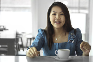 Asian female beautiful women portraits with coffee cup, chinese girl relax life style in the cafe