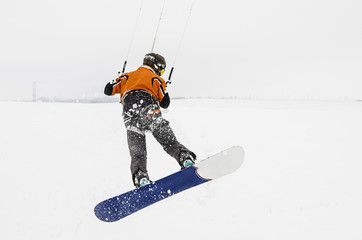 Snowboarder on the kite. Bounce