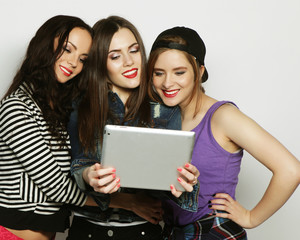 girls friends taking selfie with digital tablet