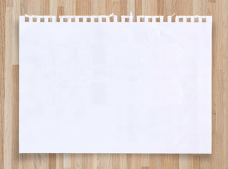 White paper sheet on vintage wood texture with clipping path.