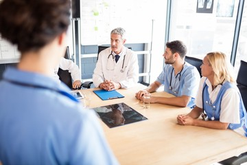Medical team talking together in meeting
