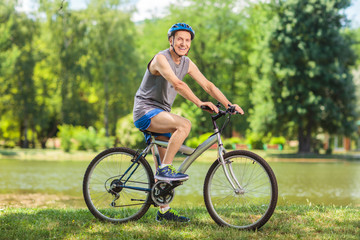 Active senior man riding a bike in park