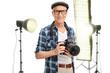 Senior photographer standing in a studio