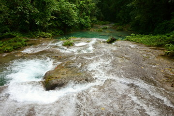 Reach Falls waterfalls and surrounding lush tropical rain forests not too far from Port Antonio are one of the most popular tourist destinations and attractions in Portland parish, Jamaica.