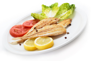 Grilled wedge sole and vegetables. Spanish sole fish
