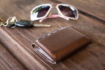 Old leather wallet on wood table
