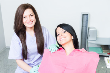 Friendly and successful female dentist doctor and patient