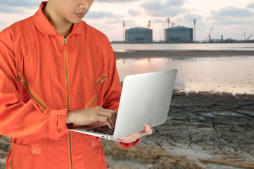 engineer use laptop with industrail estate