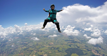 Skydiver woman falling in sitting control
