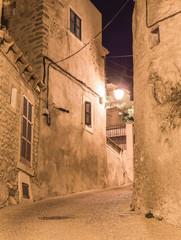 Wall Mural - Old rustic alleyway at night