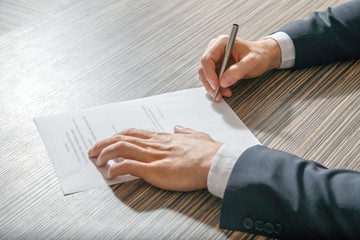 Business worker signing the contract