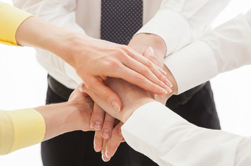 Business people uniting their hands - gesture of a uniion