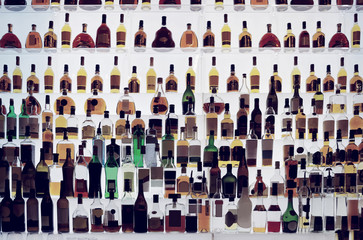 Various alcohol bottles in a bar, toned
