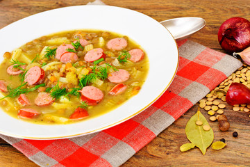 Healthy and Diet Food: Soup with Lentils, Celery and Sausage