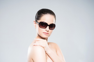 Beauty portrait of young, attractive, fresh, healthy and natural woman in sunglasses