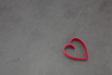 Single heart on a slate background