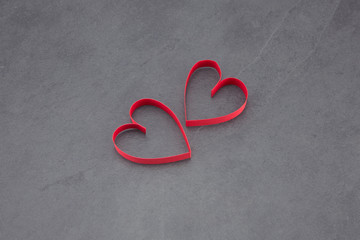 Two hearts on a slate background