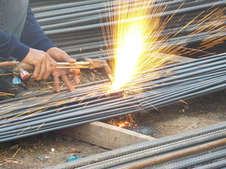 A cutting torch to cut rebar