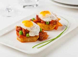 Fried eggs and chorizo
