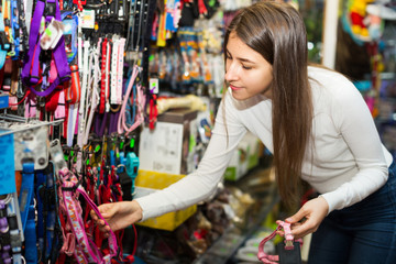 Girl selecting collars and leads