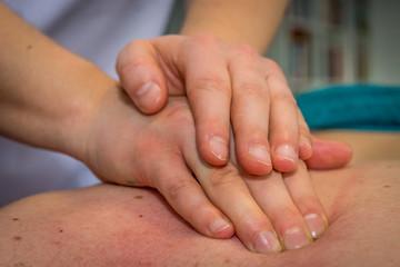 Back massage, closeup to hands