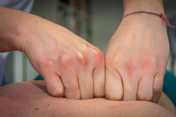 Back massage with knuckles, closeup to hands