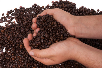 Heart shaped coffee beans held in hands