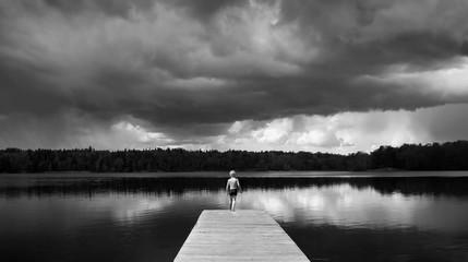 Boy standing on a Footbridge