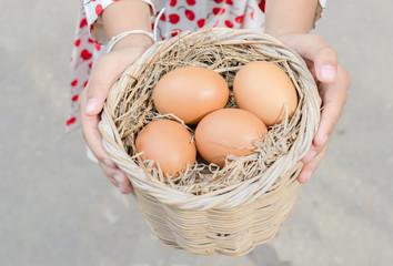 Fresh eggs in basket.