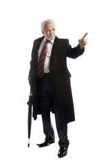 Elderly businessman with an umbrella and coat