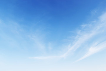 Fantastic soft white clouds against blue sky background, soft fo