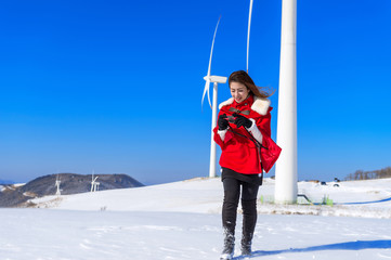 Young woman is a happiness with camera in winter of sky and wint