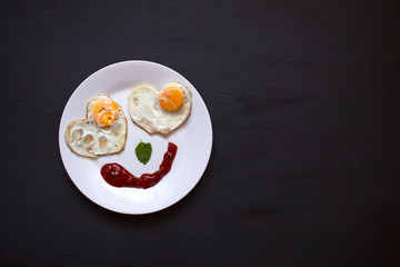 Breakfast, fried eggs in the shape of hearts, smiley,bright morn