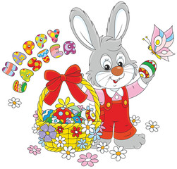 Little grey bunny with a happy Easter greeting and with a decorated basket of colorfully painted eggs