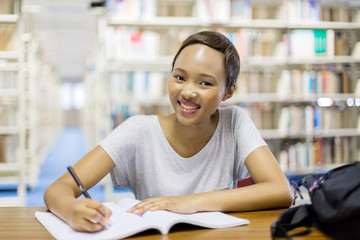 african american university student in library