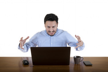 Furious Businessman Looking At Laptop Screen Isolated On White Background
