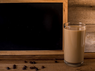 A glass of coffee milk with blank blackboard for text.