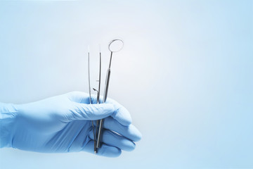 Close-up of dentist's hands and dental equipment
