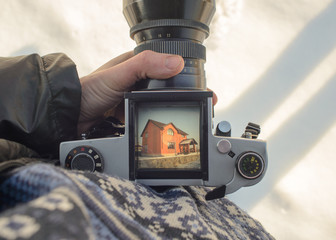 man photographer is making house photography with old film camera
