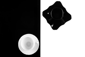 coffee cups on white and black