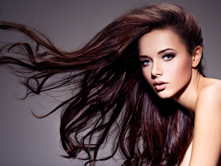 Tuinposter Kapsalon Portrait of the beautiful young woman with long brown hair