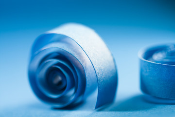 Macro, abstract, background picture of blue paper spirals on paper background