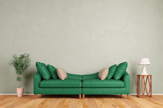 Grünes Sofa vor Wand im Wohnzimmer