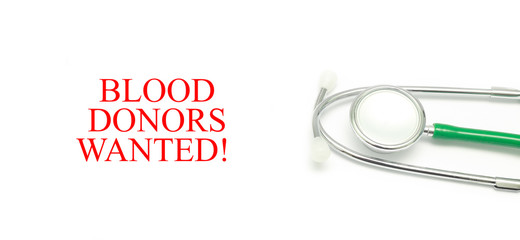 Close up Stethoscope and words Blood Donors Wanted! over white background