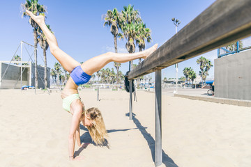 Woman training on the beach