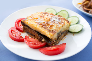 Delicious Greek moussaka with aubergine and vegetable salad