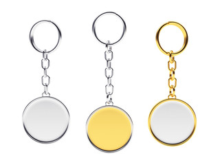 Blank round golden and silver key chains with key rings isolated on white background
