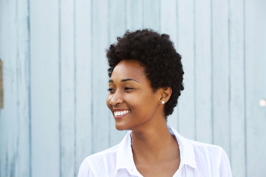 Happy young african woman looking away and smiling