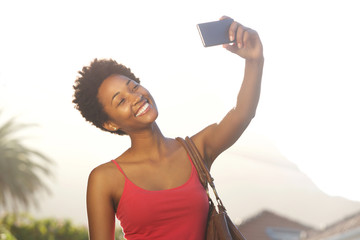 Attractive young african woman taking a selfie